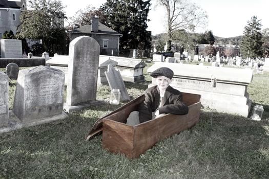 Boy in coffin