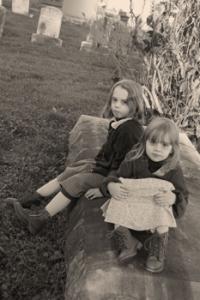 Two children in cemetery
