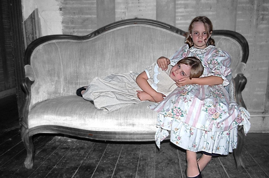 Two little girls on a couch