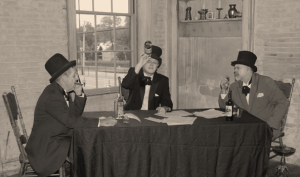 Three men sitting at a table
