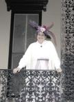 Woman at a balcony