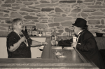 Woman behind a bar arguing with man